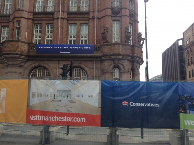 Taken outside of the Conservative Party conference in Manchester last October. Notice the themes of security and stability.