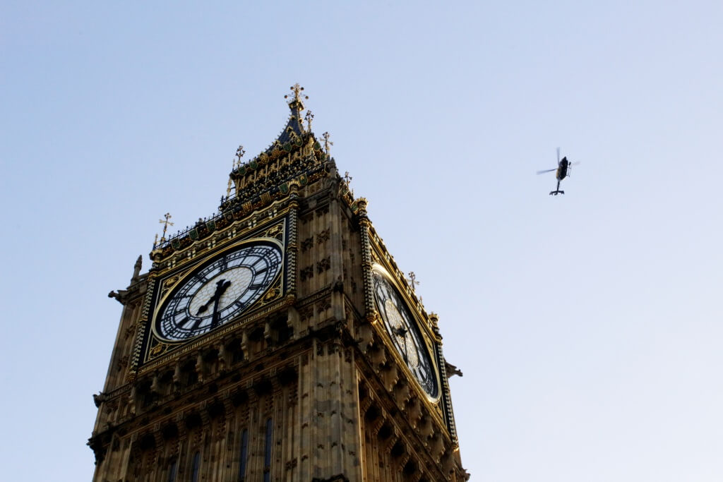 A helicopter flying over Big Ben